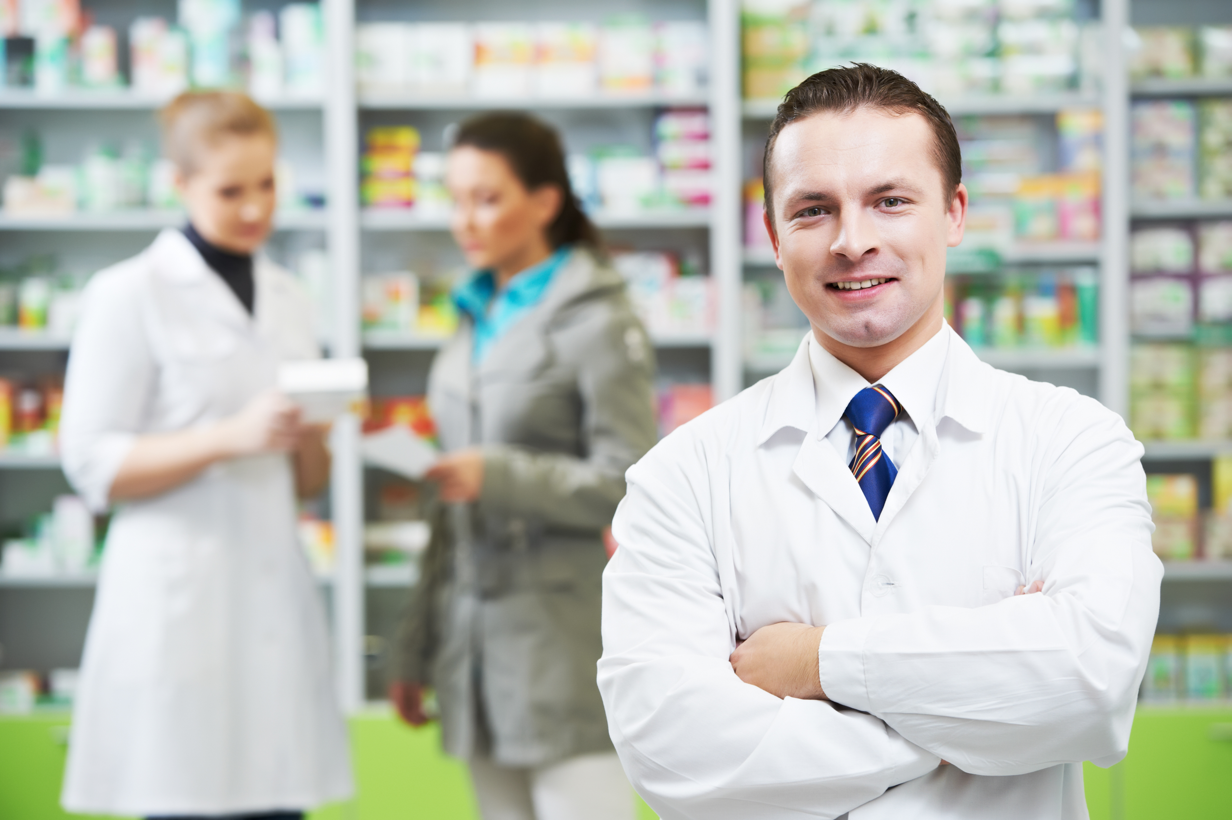 A Pharmacist Aids A Customer To Be