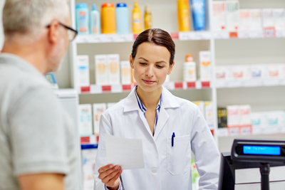 Pharmacist serving customer